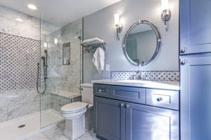 a modern bathroom with a low-flush toilet and low flow shower faucet